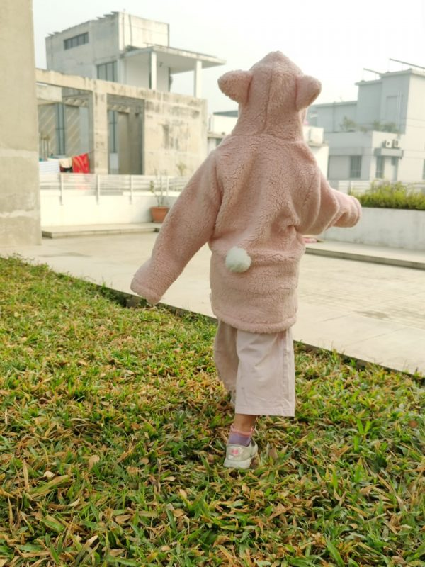 The image displays Gorur Ghash newest collection of a cute oversized hoodie for kids (toddlers). The hoodie comes in pink and is known as The Sheep. It has been proudly made in Bangladesh (BD)
